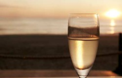 A glass of chilled white wine to toast the setting sun